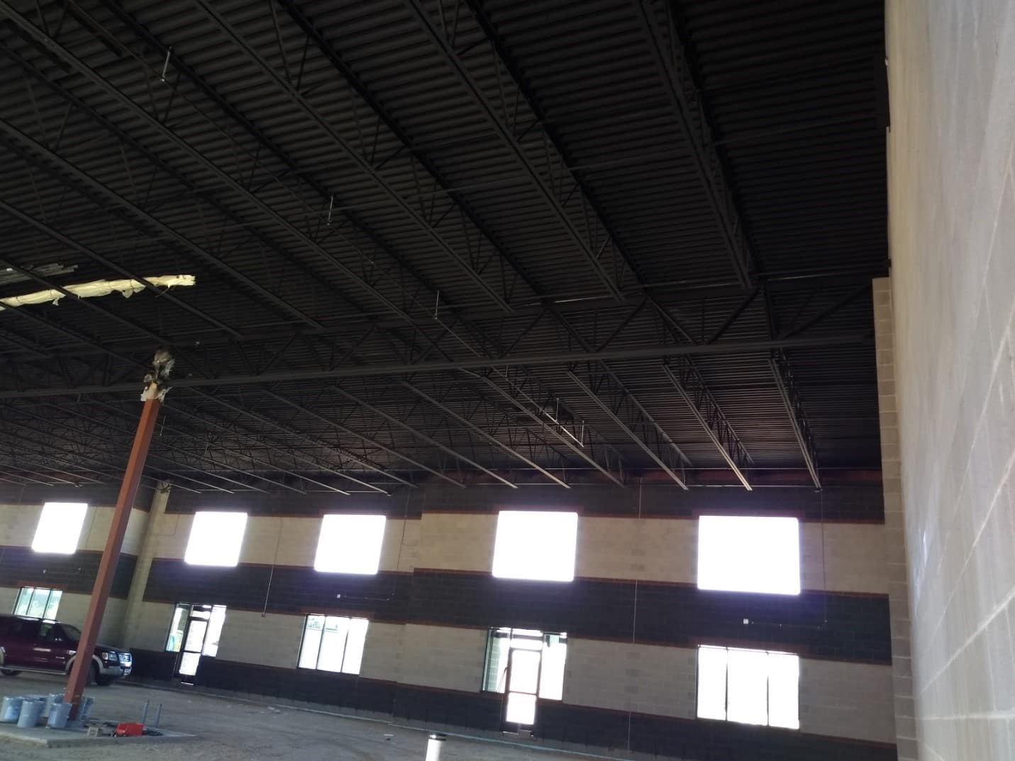 Interior of a large warehouse that needs professional commercial painting