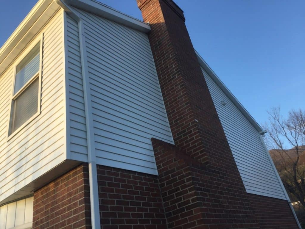 House exterior with newly painted wood and brick surfaces
