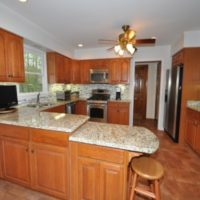 Newly painted wood-finish kitchen cabinets and counters in Layton, UT