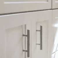Newly painted doors and steel handles of a bathroom cabinet