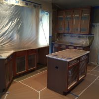 Ongoing painting project on wooden home kitchen cabinets in Bountiful, Utah